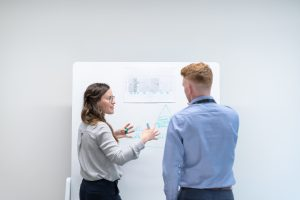 Female engineer discussing white board